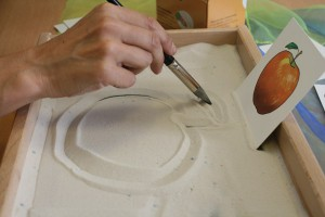 Bandeja de arena para aprender a dibujar